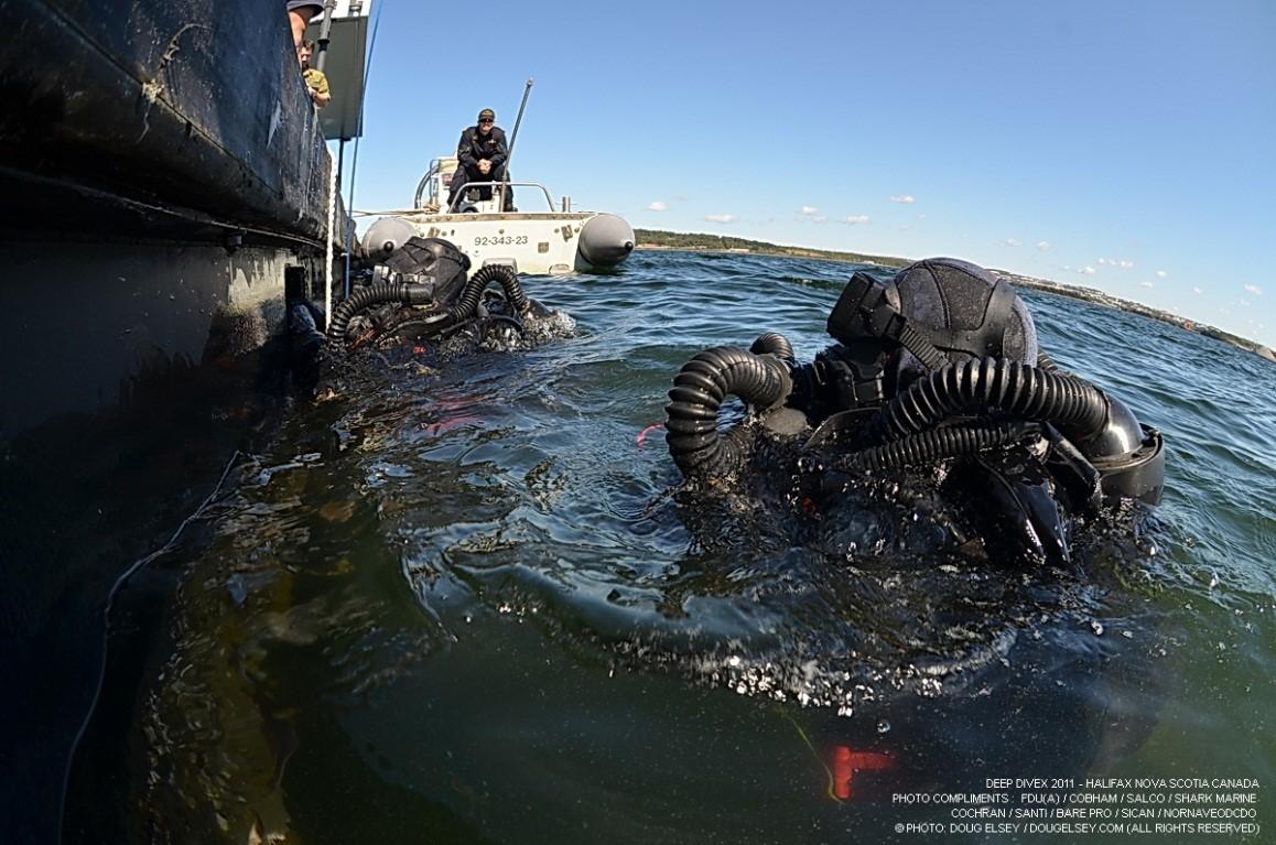 Mergulhadores Militares com Equipamentos de HELIOX